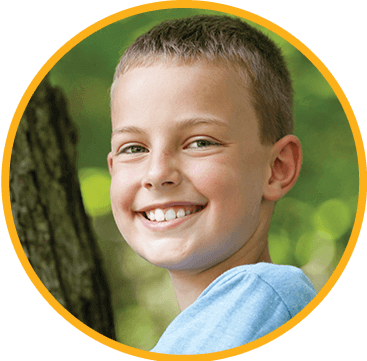 Kid with crown smiling