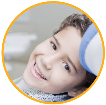 A young boy smiling in the dental chair